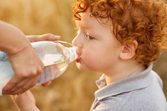 Baby boy drinking water Stock Photos