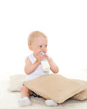 Baby boy drinks milk from bottle. Royalty Free Stock Images