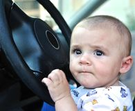 Baby boy driving Stock Photography