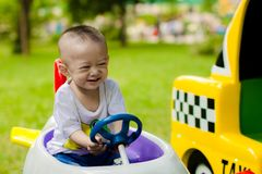 Baby boy driving toy car
