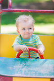 Baby boy driving a toy car at the playground Royalty Free Stock Photos