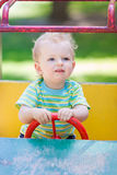 Baby boy driving a toy car at the playground. Outdoor Royalty Free Stock Photo