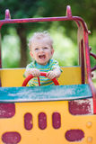Baby boy driving a toy car at the playground. Outdoor Royalty Free Stock Image
