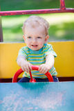 Baby boy driving a toy car at the playground Royalty Free Stock Photo