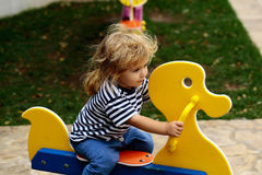 Baby boy on duck swing Stock Photo