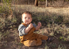 Baby boy in early spring nature. Baby boy in early spring sunset, nature Royalty Free Stock Photography