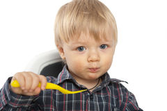 Baby boy eating Royalty Free Stock Photos