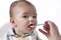 Baby Boy Is eating Stock Image
