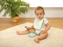 Baby boy eating Stock Image