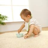 Baby boy eating Royalty Free Stock Photos