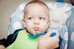 Baby boy eating Stock Photo