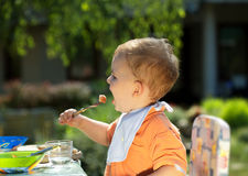Baby boy eating Stock Photos