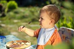Baby boy eating Royalty Free Stock Photo