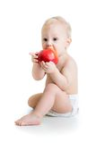 Baby boy eating apple, isolated on white Stock Photography