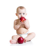Baby boy eating apple, isolated on white Stock Image