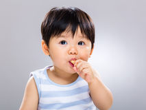 Baby boy eating biscuit Stock Photography