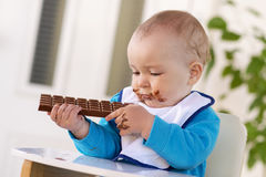 Baby boy eating chocolate Stock Photo