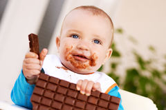 Baby boy eating chocolate Royalty Free Stock Images