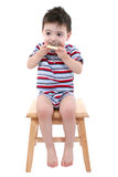 Baby Boy Eating Chocolate Iced Sugar Cookie Over White royalty free stock images