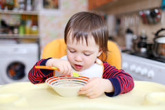 Baby boy eating Royalty Free Stock Photography