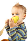 Baby boy eating pear Royalty Free Stock Photo