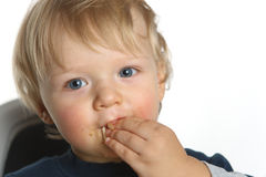 Baby boy eating portrait Royalty Free Stock Image