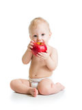 Baby boy eating red apple Royalty Free Stock Image