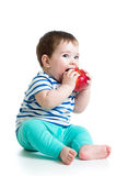 Baby boy eating red apple Stock Photo