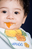 Baby boy eating solid food royalty free stock photography