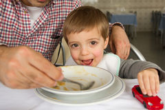 Baby boy eating soup Stock Photography