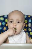 Baby boy eating vegetables Stock Photos