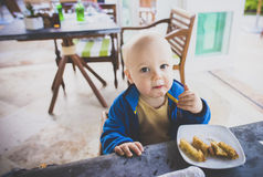 Baby Boy Eats Breakfast at a Resort in Mexico Stock Images