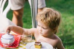 Baby boy eats dessert Stock Images