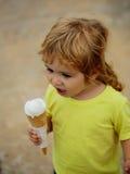 Baby boy eats icecream Royalty Free Stock Photos