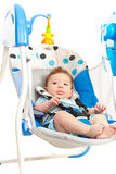 Baby boy in electrical swing Stock Photography