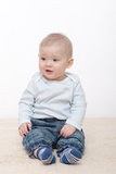 Baby boy sits Stock Photo