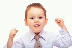 Baby boy expressing achievement and success. On white Stock Photo