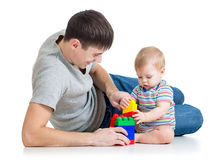 Baby boy and father playing together Stock Photo