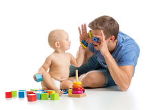 Baby boy and father playing together Royalty Free Stock Image