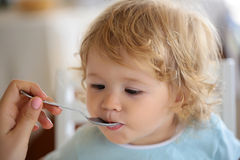 Baby boy fed with spoon Royalty Free Stock Photography