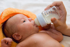 Baby boy and feeding bottle Stock Photography