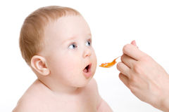 Baby boy  feeding isolated Stock Images