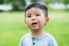 Baby boy feeling scorn. Baby asian boy feeling scorn stock photography