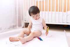 Baby boy with felt-pens at home Royalty Free Stock Photography