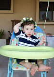 Baby Boy first birthday. Cute baby boy holding his birthday bouquet royalty free stock image