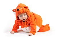Baby boy in fox costume looking down with surprise Royalty Free Stock Image