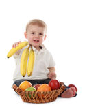 Baby boy and fruits Royalty Free Stock Photo