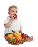 Baby boy and fruits Royalty Free Stock Photography