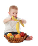 Baby boy and fruits Stock Photography