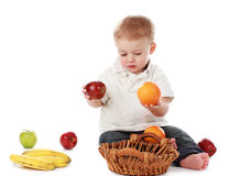 Baby boy and fruits Royalty Free Stock Images
